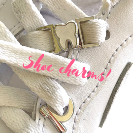 Shoe charm golden tooth