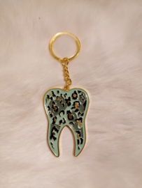 Sleutelhanger tand goud mint luipaard