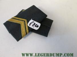 "Landmacht onderscheidingsteken ""Sergeant 1""."