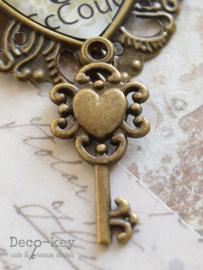 Bedel sleuteltje hartje brons