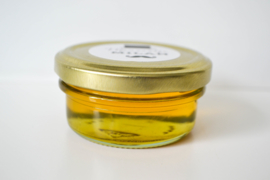Glazen potje goud met 100% natuurlijke honing