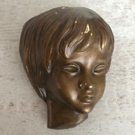 Wandkopje brons