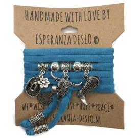 """Turquoise blauwe armband met zilverkleurige bedels thema """"Buffalo"""""""