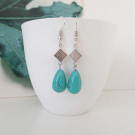 Zilverkleurige turquoise druppel oorbellen