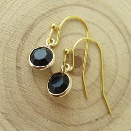 Goudkleurige oorbellen met zwart bedel
