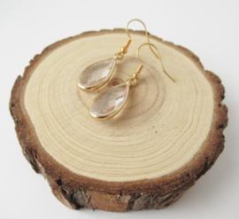 Goudkleurige transparant druppel oorbellen