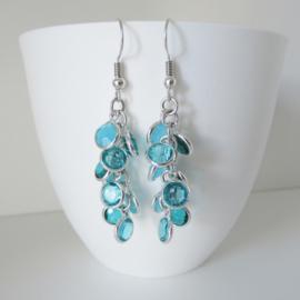 Zilverkleurige aqua blauw oorbellen