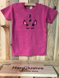 Een roze t-shirt met unicorn maat 98