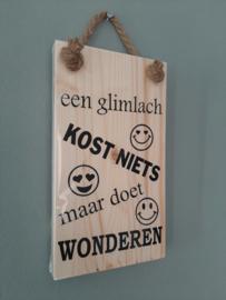 Een glimlach kost niets