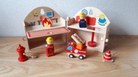 Draagbaar houten brandweerkazerne to-go