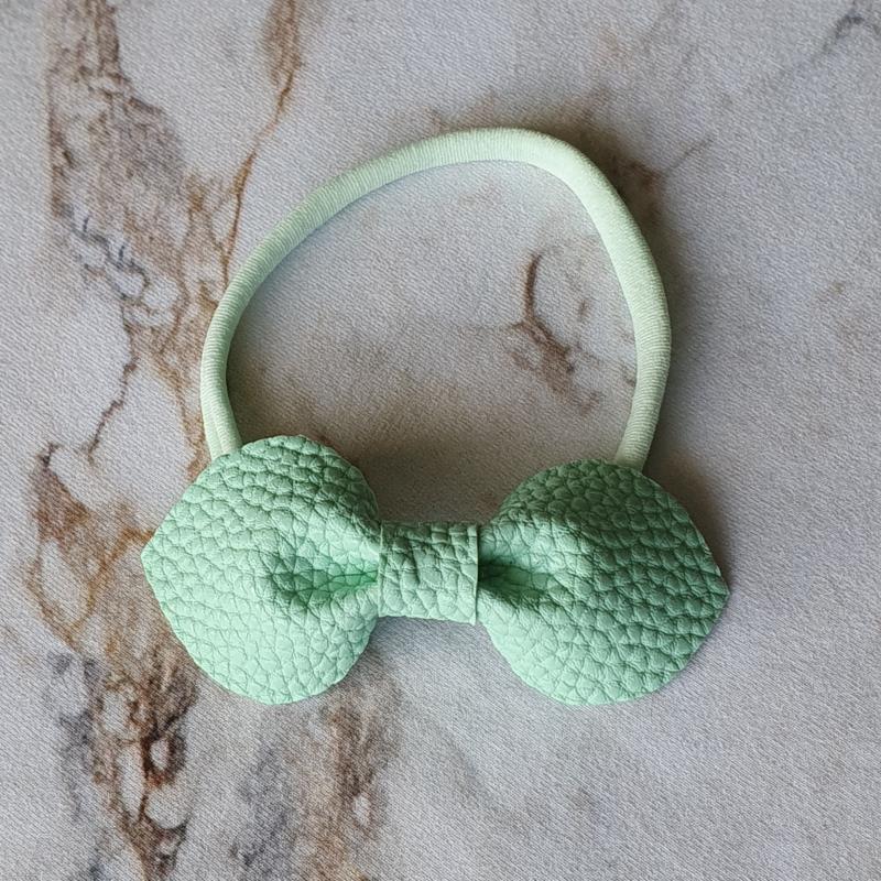 Nylon haarbandje met kunstleren strik - mint