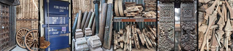 Oude bouwmaterialen van links naar rechts: oude deuren, grote houten wielen, container deur, houten pilaren, teak tafelbladen, oud hekwerk