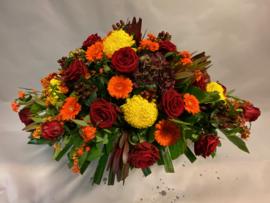 Traditioneel rouwstuk met herfst kleuren