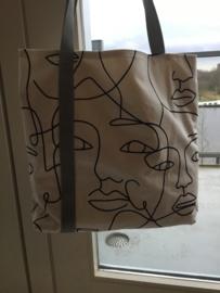 Tas met gezichten