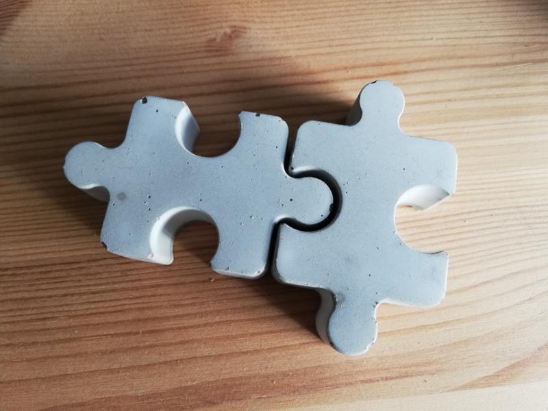 Puzzelstukje van beton