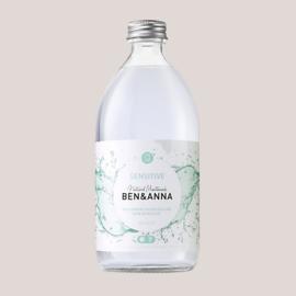 Mondwater in een glazen fles