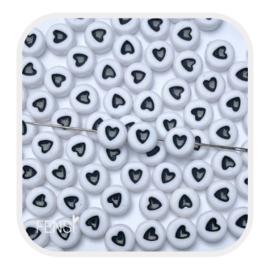 Acryl kralen met zwart hart - 10 stuks