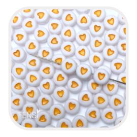 Acryl kralen met geel hart - 10 stuks