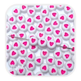 Acryl kralen met roze hart - 10 stuks