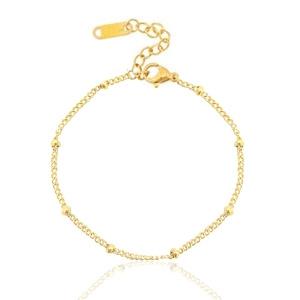 Armbandje - tiny beads - goudkleurig
