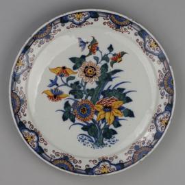 Twee borden met kleurrijke bloemen