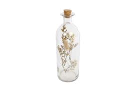 Droogbloemen in glazen fles met kurk