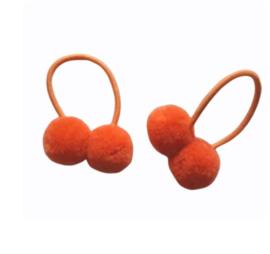 Haar elastiekjes met pompon oranje