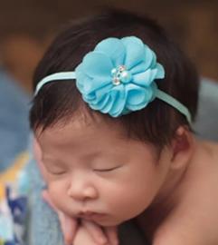 Haarband turquoise met luxe bloem