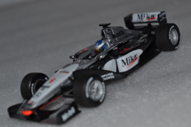 Mika Hakkinen Mc Laren Mercedes MP4-14 race car World Champion 1999 season