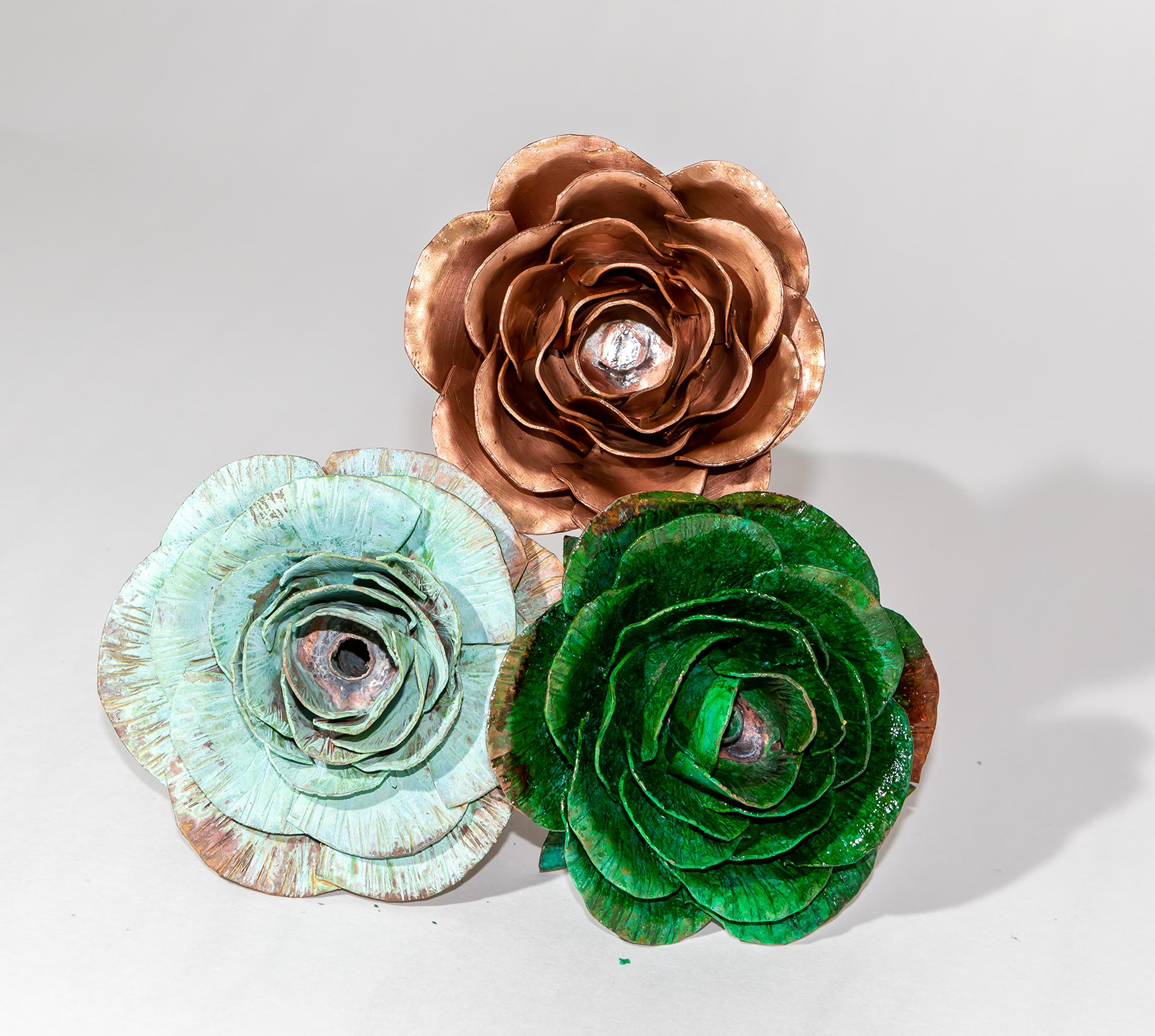 Drietal rozen van koper