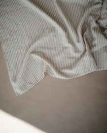 Mushie swaddle (sage stripes)
