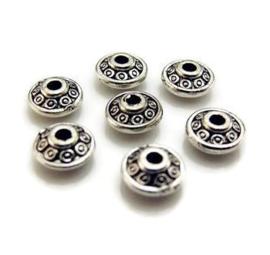 Metalen kraal zilverkleur 6x4,5 mm  - 10 stuks