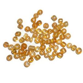 Glas rocaille 4mm (6.0) Goudgeel AB - Per zakje ca 5 gram
