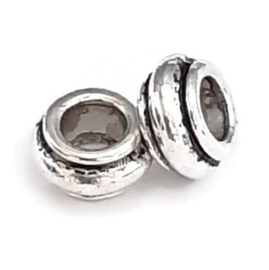 Metalen kraal met groot gat -  glad met rand - 9x5mm - gat 4.8mm