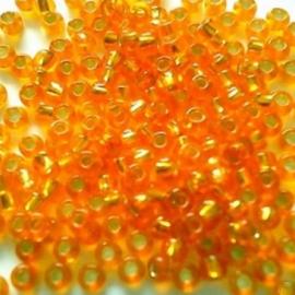 Glas rocaille 2mm (12.0) Oranje Silverlined - Per zakje  10 gram (ca.800st.)