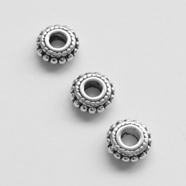 Spacer kralen metaal zilverkleur 7,5x3mm gat ca 3mm  - 5 stuks